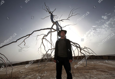 Us Artist Roxy Paine who Lives in Brooklyn New York Stands in Front of His Huge Huge Stainless Steel Inverted Tree Sculpture Called 'Inversion' As It is Completed in the Billy Rose Sculpture Garden in the Israel Museum in Jerusalem on 27 January 2011 the Piece Weighs Some 4-tons and was Shipped to Israel in Containers and Then Its Branches Welded Into Position with the Help of Cranes Israel Jerusalem