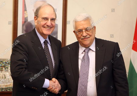Palestinian President Mahmoud Abbas (r) Shake Hands with Us Middle East Peace Envoy George J Mitchell in Amman Jordan on 22 March 2010 Mitchell Met in Jerusalem Yesterday 21 March with Israeli Prime Minister Benjamin Netanyahu Kicking Off the 'Indirect Talks' Meant to Lead to Direct Talks with the Palestinian Side Atfter a Break of a Week Due to the Controversary Over Israel's Expansion Building Plans For Arab East Jerusalem Jordan Amman
