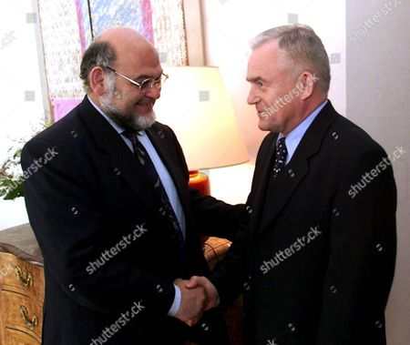 Warsaw Poland : French Communist Party Secretary General Robert Hue (l) Shake Hands with Leszek Miller the Secretary General of Sld (democratic Left Alliance) in the Residence of the French Ambassador on 08 July 2000 Hue is on a Two Day Visit to Poland