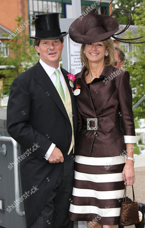 Mr and Mrs Guy Sangster wearing a Bruce Oldfield hat