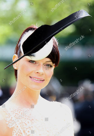 Paula McNeill wearing a PhilipTreacy hat