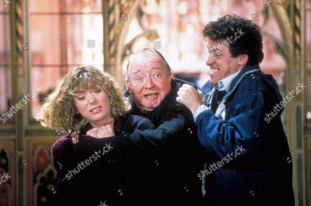 'Wilt'    Film  Henry Wilt (Griff Rhys Jones) Right, Tries to Get Reverend Froude (David Ryall) Away From His Wife Eva Wilt (Alison Steadman) as they Grapple in the Church