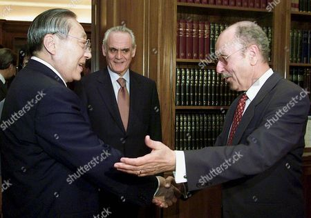 Athens Greece: Greek President Costis Stephanopoulos (r) Welcomes Chinas Vice-president Li Lanqing While Greek Minister of Development Akis Tsochatzopoulos (c) Looks on During Their Meeting in Athens Tuesday 21 May 2002 Mr Lanqing is in Athens on a Four-days Visit 2002