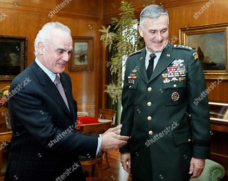 Athens Greece: Greek Minister of Defence Akis Tsochatzopoulos (l) Gestures While Welcoming the Chairman of the Us Joint Chiefs of Staff General Henry H Shelton in His Office in Athens Wednesday 2 May 2001