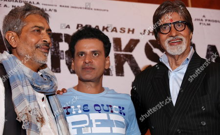 Indian Bollywood Actor Amitabh Bhachchan (r) Indian Actor Manoj Bajpai (c) and Indian Film Director Prakash Jha (l) Pose For Photographers During a Press Conference in Calcutta India 27 July 2011 Amitabh Bachchan is in Calcutta to Promote His Forthcoming Film 'Arakshan' (reservation) India Calcutta