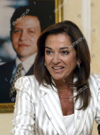 Greek Foreign Minister Dora Bakoyianni Speaks in Front of a Portrait of Jordanian King Abdullah During a Press Conference at Amman Airport Before Leaving Amman on Thursday 24 August 2006 Jordan Amman