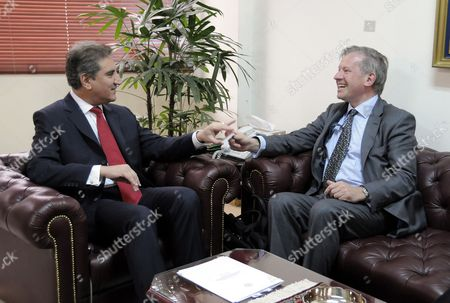Stock Photo of Paistan's Foreign Minister Shah Mehmood Qureshi (l) Talks with British Special Envoy to Afghanistan and Pakistan Sherard Cowper-coles During Their Meeting in Islamabad Pakistan on 10 March 2010 Sherard Cowper-coles Has Been Appointed As Special Envoy For the Two Countries That Are Being Described in Western Diplomatic Circles As the Major Cause For Concern in Coming Days and Months Pakistan Islamabad