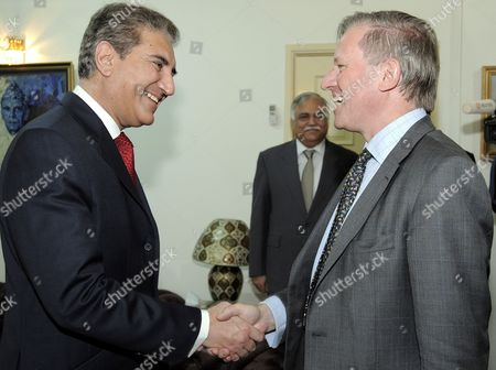 Pakistan's Foreign Minister Shah Mehmood Qureshi (l) Shakes Hands with British Special Envoy to Afghanistan and Pakistan Sherard Cowper-coles During Their Meeting in Islamabad Pakistan on 10 March 2010 Sherard Cowper-coles Has Been Appointed As Special Envoy For the Two Countries That Are Being Described in Western Diplomatic Circles As the Major Cause For Concern in Coming Days and Months Pakistan Islamabad