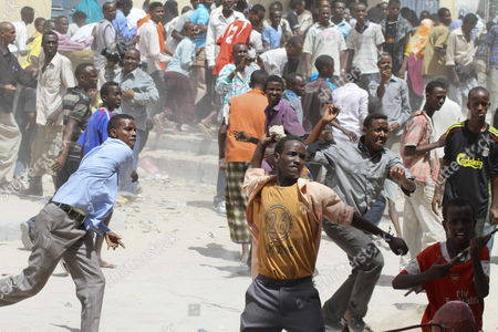Supporters of Somalia's Prime Minister Mohamed Abdullahi Mohamed Throw Rocks at Guards at Madina Hotel in Mogadishu Somalia 10 June 2011 During a Second Day of Protests Against Firing of the Premier of the Transitional Federal Government (tfg) at Least Two People Were Reportedly Killed by Soldiers Loyal to the President and Parliament the Protests Turned Violent As Premier Mohamed Planned to Announce His Resignation After the Leaders of the Government President Sheikh Sharif Ahmed and the Speaker of Parliament Sharif Hassan Sheikh Aden Reached a Deal in Kampala Uganda to Dismiss Mohamed and to Extend the Mandates of the Country's President and Parliament For 12 Months Somalia Mogadishu