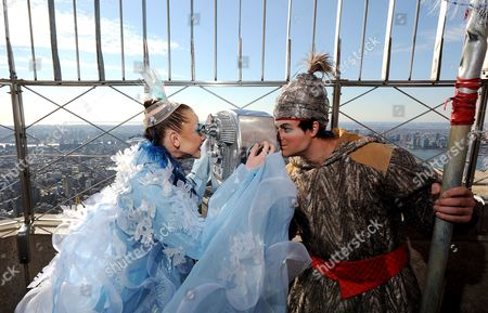 Elena Lev (l) a Hoops Performer From the Cirque Du Soleil Show 'Wintuk' and a Fellow Cast Member Joke Around with a Set of Binoculars While Performing on the Observation Deck of the Empire State Building in New York New York Usa 19 November 2010 Members of the Cast of the Show Made an Appearance at the Empire State Building to Promote the Opening Night of the Winter Themed Show United States New York
