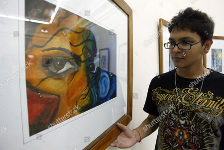 Indian Student and Artist Lakshit Sharma Shows One of His 26 Paintings and Graphic Illustrations of Late Us Singer Michael Jackson Put on Display During an Exhibition on the Occasion of His 52nd Birth Anniversary in the Northern Indian City of Amritsar 29 August 2010 Lakshit a Student of Spring Dale Senior School Said the Exhibition is a Form of Tribute to the Greatest Pop Icon Through Which He Has Tried to Capture the Varied Persona of Him India Amritsar