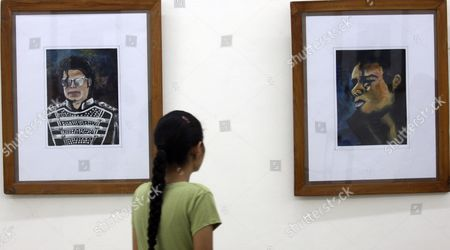 An Indian Visitor Has a Look at One of 26 Paintings and Graphic Illustrations of Late Us Singer Michael Jackson Put on Display During an Exhibition by Indian Student and Artist Lakshit Sharma (unseen) on the Occasion of Michael Jackson's 52nd Birth Anniversary in the Northern Indian City of Amritsar 29 August 2010 Lakshit a Student of Spring Dale Senior School Said the Exhibition is a Form of Tribute to the Greatest Pop Icon Through Which He Has Tried to Capture the Varied Persona of Him India Amritsar
