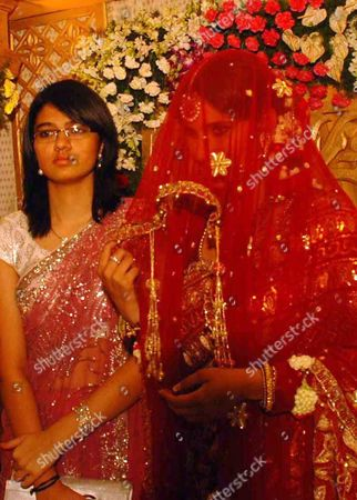 Stock Photo of Indian Tennis Star Sania Mirza (r) During Her Wedding Ceremony at a Hotel in the Southern Indian City of Hyderabad 12 April 2010 Tennis Star Sania Mirza Married Pakistani Cricketer Shoaib Malik at a Plush Hotel in Hyderabad Following a Controversy Malik Had Earlier Signed Divorce Papers Discontinuing His Marriage with Ayesha Siddiqui the Pakistani Cricketer Had Insisted That He was Emotionally Forced Into the 'Telephone Nikah' (wedding on Telephone) with the Hyderabad Girl Ayesha Siddiqui the Indian Girl Claiming to Be His Wife India Hyderabad