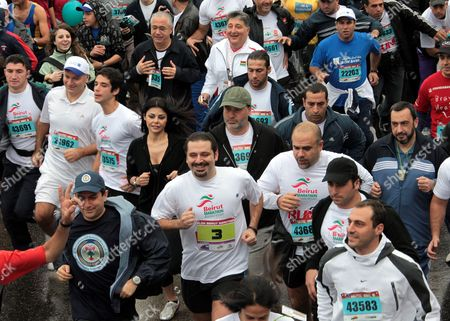 Lebanese Prime Minister Saad Hariri (c) Lebanese Interior Minister Ziad Baroud ( L) Lebanese Artist Haifa Wehbe (behind L) and Other Lebanese and Foreign Participants Take Part in the 10 Kilometers 'Fun Run' of the Annual Beirut International Marathon in Downtown Beirut Lebanon 06 December 2009 More Than 31000 Participates From 61 European and Arabic Countries Took Part in the Beirut Marathon Under the Moto'it's Time to Run' Ethiopian Mohammed Hussein Won the 42 Km Race Followed by Eston Ngiar From Kenya (2nd) and Abraham Belete From Ethiopia (3rd)