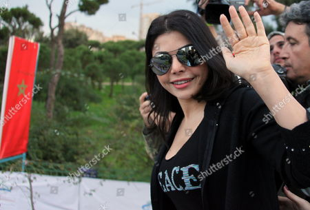 Lebanese Singer and Actress Haifa Wehbe Waves to Photographers During the Annual Beirut International Marathon Dowtown Beirut Lebanon 06 December 2009 Some 31 000 People From 61 European and Arabic Countries Participate in the Marathon Under the Motto 'It's Time to Run' Ethiopian Mohammed Hussein Won the 42 Km Race Followed by Eston Ngiar From Kenya (2nd) and Abraham Belete From Ethiopia (3rd) Respectively