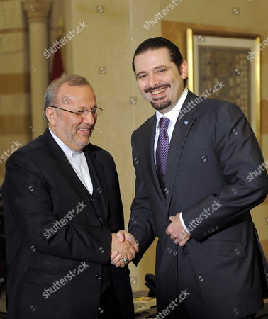 Lebanese Prime Minister Saad Hariri (r) Welcomes Iranian Foreign Minister Manuchehr Mottaki (l) at Government Palace in Beirut Lebanon 21 December 2009 Mottaki who Arrived in Beirut Late 20 December 2009 is to Meet with Lebanese President Michel Suleiman Lebanon's Parliament Speaker Nabih Berri Lebanese Prime Minister Saad Hariri and Lebanon's Foreign Minister Ali Shami Regional Issues and Other Mutual Interests Will Be Discussed During Mottaki's Appointments with the Lebanese Officials Lebanon Beirut