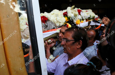 The body of noted Indian character actor Om Puri is carried for cremation in Mumbai, India, . In a career spanning more than three decades, Puri had won a slew of national awards and international fame for his work in several critically acclaimed films. He was made an honorary officer of the Order of the British Empire for his contribution to British cinema in 2004