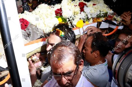 Stock Photo of The body of noted Indian character actor Om Puri is carried to an ambulance for cremation in Mumbai, India, . In a career spanning more than three decades, Puri had won a slew of national awards and international fame for his work in several critically acclaimed films. He was made an honorary officer of the Order of the British Empire for his contribution to British cinema in 2004