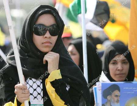 Bahraini Women March On the Outskirts of the Capital Manama During the Annual International Quds (jerusalem) Day On 05 October 2007 Thousands of Bahrainis Mainly Shiites Took to the Streets Answering the Annual Call by the Late Founder of the Iranian Islamic Republic Grand Ayatollah Seyyed Ruhollah Musavi Khomeini Demonstrators Marched Through Mainly Shiite Villages Chanting Death to America Death to Israel and Israel Must Be Wiped Off the Map Hundreds of Women in Black Chador Also Took Part in the March where Larger Posters of Ayatollah Khomeini Were Raised Alongside Pictures of Irans Present Supreme Leader Seyyed Ali Khamenei and the General Secretary of the Lebanese Hezbollah Seyyed Hassan Nasrallah