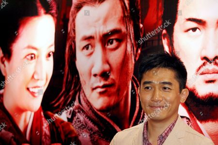 Hong Kong Actor Tony Leung Chiu Wai Poses For Photographers at a Press Conference to Promote His Movie 'Red Cliff' by Chinese Director John Woo in Hong Kong China 30 June 2008 the Movie is Based On the Battle of Red Cliffs and Events During the Three Kingdoms Period in Ancient China