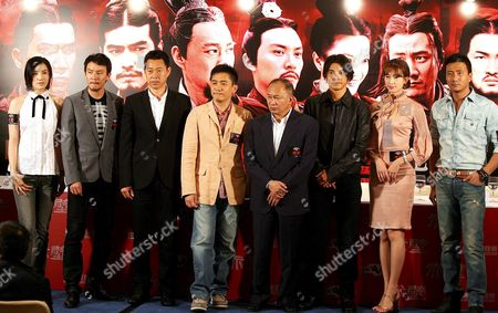(l-r) Chinese Actress Son Jia Taiwanese Actor Chen Chan Chinese Actor Zhang Fengyi Hong Kong Actor Tony Leung Chiu Wai Chinese Director John Woo Japanese-taiwanese Actor Takeshi Kaneshiro Taiwanese Actress Chiling Lin Chi Ling and Chinese Actor Hu Jun Pose For Photographers at a Press Conference to Promote Their Movie 'Red Cliff' China 30 June 2008 the Movie is Based On the Battle of Red Cliffs and Events During the Three Kingdoms Period in Ancient China
