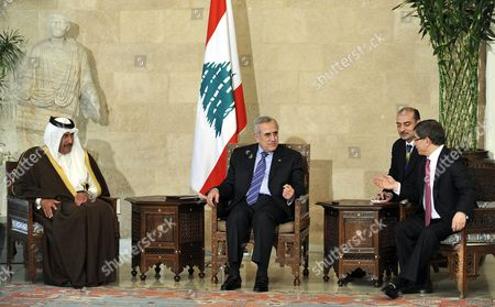 Lebanese President Michel Suleiman (c) Meets with Qatar's Prime Minister and Foreign Minister Sheikh Hamad Bin Jassim Bin Jaber Al-thani (l) and Turkey's Foreign Minister Ahmet Davutoglu (r) at the Presidential Palace in Baabda East Beirut Lebanon 18 January 2011 Person at 2ndr is an Unidentied Interpreter Lebanon Baabda