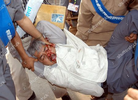 Former Nepalese Deputy Prime Minister and Central Leader of the Country's Communist Party of Nepal Bamdev Gautam is Carried to Hospital After a Clash During a Demonstration in Katmandu Nepal On Sunday 4 March 2004 the Five Opposition Political Parties Have Pressing King Gyanendra to Restore the House of Parliament and the Fresh Election in the Country