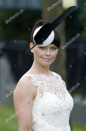 Stock Picture of Paula McNeill wearing a PhilipTreacy hat