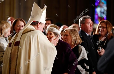 Joseph Cardinal Tobin, left, greets his mother, Marie Terese Kerwin before heading to the altar to be installed as the new archbishop of Newark, N.J., during a Mass ceremony, in Newark, N.J. Tobin succeeds Archbishop John Myers, who reached the mandatory retirement age of 75 in July