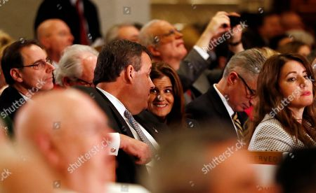 New Jersey Gov. Chris Christie, center left, talks to first lady Mary Pat Christie while attending a Mass ceremony installing Joseph Cardinal Tobin as the new archbishop of Newark, in Newark, N.J. Tobin succeeds Archbishop John Myers, who reached the mandatory retirement age of 75 in July