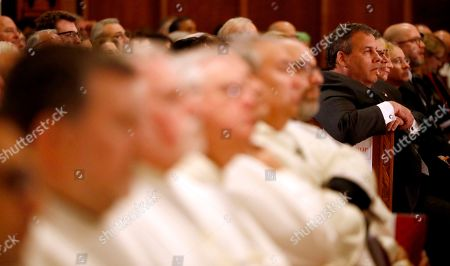 New Jersey Gov. Chris Christie, right, attends a Mass ceremony installing Joseph Cardinal Tobin as the new archbishop of Newark, in Newark, N.J. Tobin succeeds Archbishop John Myers, who reached the mandatory retirement age of 75 in July