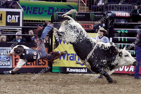 Paulo Ferreira Lima, from Brazil, is tossed from Blind Spot during the Professional Bull Riders Buck Off at New York's Madison Square Garden