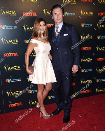 Stock Photo of Julian McMahon and Kelly Paniagua