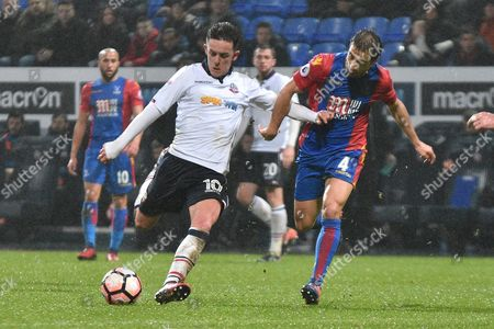 Bolton Wanderers Forward, Zach Clough (10) ansd Crystal Palace Midfielder,  Mathieu Flamini (4) during the The FA Cup 3rd round match between Bolton Wanderers and Crystal Palace at the Macron Stadium, Bolton