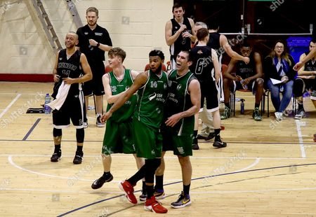 Hula Hoops Men's National Cup Semi-Final, Neptune Stadium, Cork 7/1/2017. SSE Airtricity Moycullen vs Griffith Swords Thunder. Moycullen's Kyle Cunningham and Phillip Lawrence-Ricks celebrate with Paul Freeman as he scores from long-distance on the buzzer