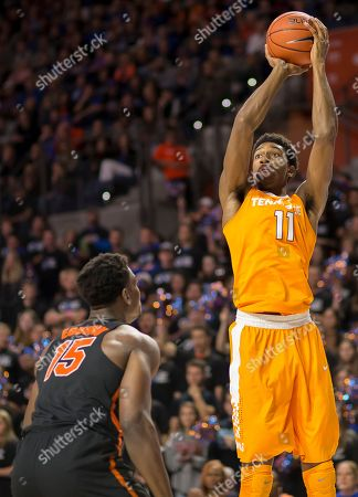 Kyle Alexander, John Egbunu Tennessee forward Kyle Alexander (11) shoots over Florida center John Egbunu (15) during the first half of an NCAA college basketball game in Gainesville, Fla. on . Florida won 83-70
