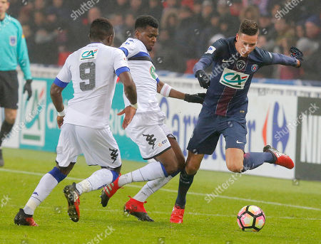 PSG's Julian Draxler, right, challenges for the ball with Bastia's Abdoulaye Keita, left, and Abdoulaye Sadio Diallo during a French Cup soccer match Paris Saint-Germain against Bastia at Parc des Princes stadium in Paris