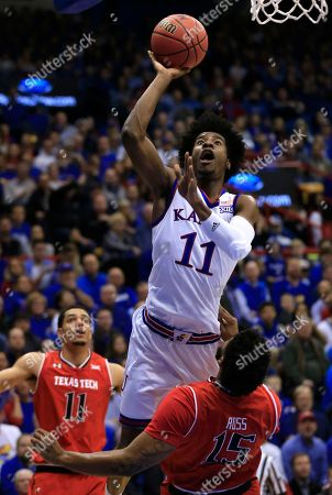 Josh Jackson, Aaron Ross Kansas guard Josh Jackson (11) charges into Texas Tech forward Aaron Ross (15) during the first half of an NCAA college basketball game in Lawrence, Kan