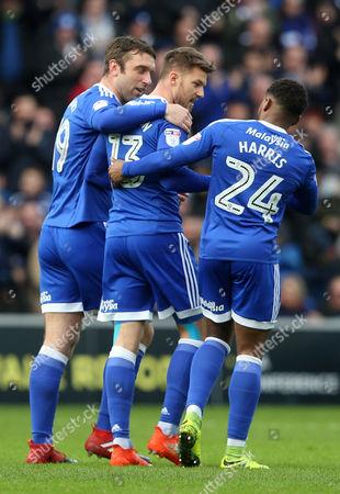 Anthony Pilkington of Cardiff City celebrates scoring a goal with Rickie Lambert and Kadeem Harris.