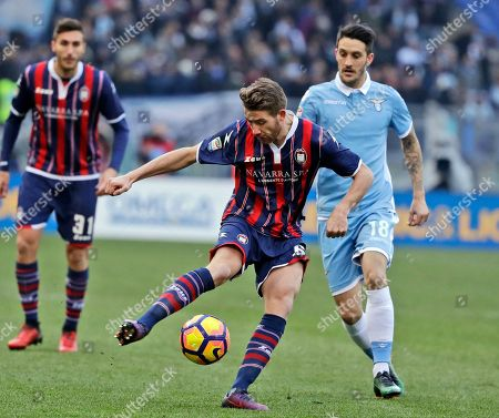 Crotone's Marcus Rohden, left, and Lazio's Luis Alberto fight for the ball during a Serie A soccer match between Lazio and Crotone, at Rome's Olympic Stadium