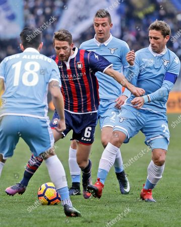 Crotone's Marcus Rohden, second from left, fights for the ball with, from left, Lazio's Luis Alberto, Sergej Milinkovic-Savic during and Lucas Biglia during a Serie A soccer match between Lazio and Crotone, at Rome's Olympic Stadium