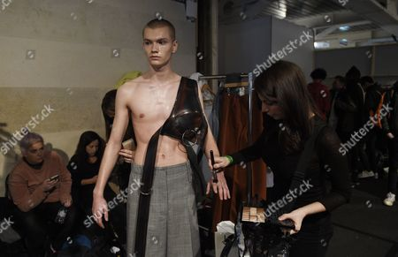 Stock Photo of A model gets groomed backstage before the show by Ximon Lee during the London Men's Fashion Week, in London, Britain 08 January 2017. The Mens collections are presented until 09 January.