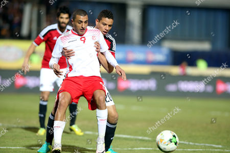 Egyptian player Saad Samir (R) in action against Tunisian Ahmed Alakeshii (L) during a friendly soccer match as preparation for the 2017 African Cup of Nations between  Egypt and Tunisia at the Cairo Stadium in Cairo, Egypt, 08 January 2017.