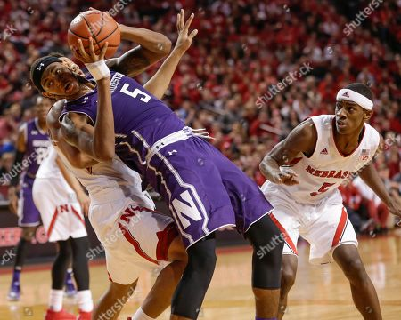Dererk Pardon, Ed Morrow, Glynn Watson Jr Northwestern's Dererk Pardon (5) commits a foul against Nebraska's Ed Morrow, left rear, as Nebraska's Glynn Watson Jr. (5) watches during the second half of an NCAA college basketball game in Lincoln, Neb