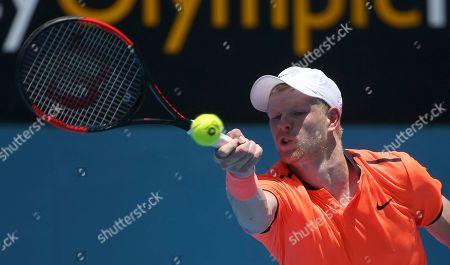 Britain's Kyle Edmund plays a shot to Australia's Matthew Barton during their men's singles match at the Sydney International tennis tournament in Sydney