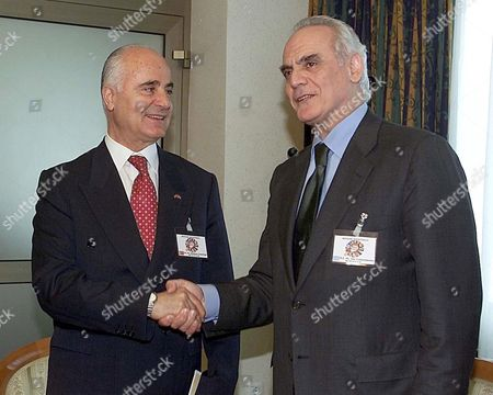 Skopje Macedonia : Greek Minister of Defence Akis Tsochatzopoulos (r) Shakes Hands with His Turkish Counterpart Sabahtin Cakmakogly (l) During Their Meeting on the Fringe of a Regional Security Conference with Defence Ministers From South-eastern European Countries Attending Thursday 05 April 2001