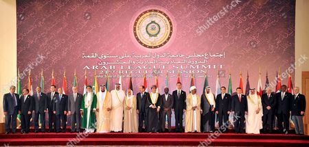 Stock Photo of Arab Leaders Pose For a Group Photo Before the Opening Session of the Arab Summit in Doha Qatar 30 March 2009 the Appearance of Sudan's President Omar Hassan Al-bashir Flouting an International Arrest Warrant is Set to Overshadow Efforts to Heal a Deep Arab Rift Over How to Handle Rising Power Iran From L to R Are: Arab League Secretary General Amr Moussa Yemen President Ali Salah Mauritanian President General Mohamed Ould Abd Aziz Morocco Prince Moulay Rachid Egyptian Minister For Legal and Parliamentary Affairs Mufid Shehab Lebanese President Michel Sulieman Comores Islands President Ahmed Abdallah Sambi Uae President Sheikh Khalifa Bin Zayed Al-nahayan Qatari Emir Sheikh Hamad Bin Khalifa Al-thani Kuwaiti Emir Sheikh Sabah Al-ahmad Al-sabah Iraqi Prime Minister Nuri Al-maliki Oman Deputy Prime Minister Sayyd Fahad Bin Mahmoud Al-said Somali President Sheikh Sharif Ahmed Syrian President Bashar El Assad Sudan President Omar Hassan El Bashir Saudi Arabian King Abdullah Tunisian President Zine El Abidine Ben Ali Jordanian King Abdullah Bahrain King Hamad Bin Isa Al-khalifa and Palestinian President Mahmoud Abbas Two Men at Far Right Are Unidentified
