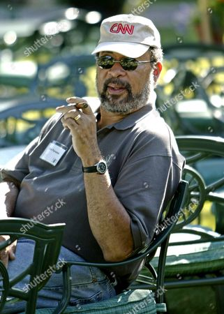 Dick Parsons Chairman and Ceo of Time Warner Aol Inc Enjoys a Cigar at the Second Day of Meeting at Allen and Company's 22nd Annual Media Conference in Sun Valley Idaho Thursday 08 July 2004