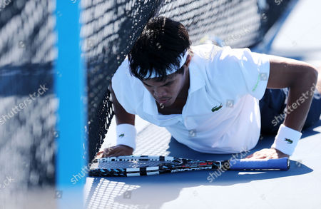 Somdev Devvarman of India Falls to the Court During His 1st Round Match Against Bjoern Phau of Germany at the Australian Open Grand Slam Tennis Tournament in Melbourne Australia 14 January 2013 Australia Melbourne