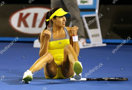 Ana Ivanovic of Serbia Falls to the Floor and Celebrates During Her 1st Round Match Against Melinda Czink of Hungary at the Australian Open Grand Slam Tennis Tournament in Melbourne Australia 14 January 2013 Australia Melbourne